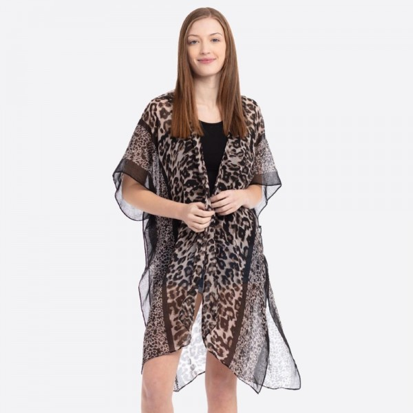 "Women's Lightweight Sheer Multi Leopard Print Kimono.  - One size fits most 0-14 - Approximately 37"" L - 100% Polyester"