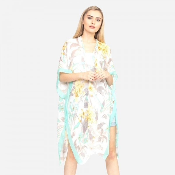 """Lightweight solid bordered floral kimono.  - One size fits most 0-14 - Approximately 37"""" L - 100% Polyester"""