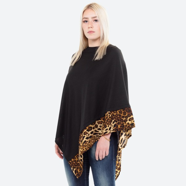 "All year around solid black poncho with leopard print trim.  - One size fits most 0-14 - Approximately 27"" L - 100% Acrylic"