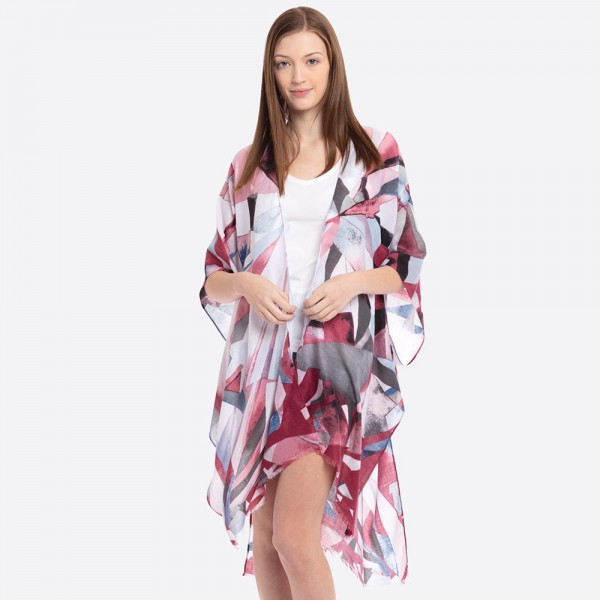 """Mosaic print kimono.  - One size fits most 0-14 - Approximately 37"""" in length - 60% Cotton, 40% Polyester"""