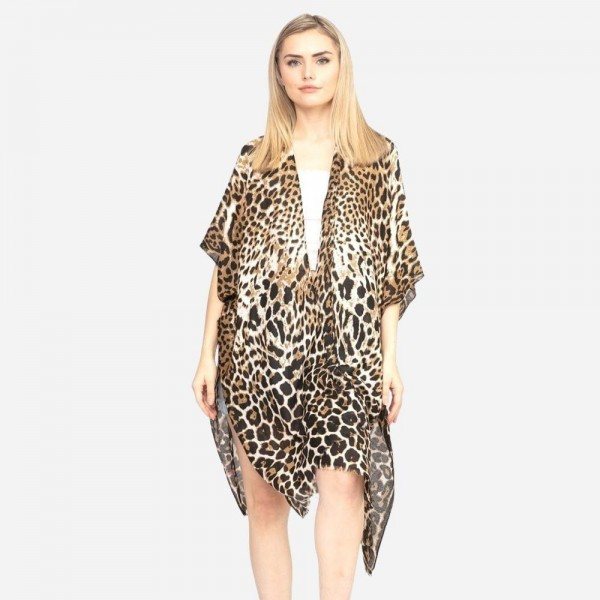 "Women's Lightweight Sheer Leopard Print Kimono.  - One size fits most 0-14 - Approximately 37"" L - 100% Polyester"
