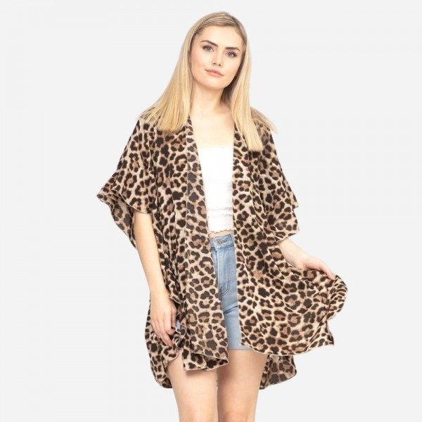 "Women's Lightweight Leopard Print Kimono.  - One size fits most 0-14 - Approximately 33"" L - 100% Polyester"