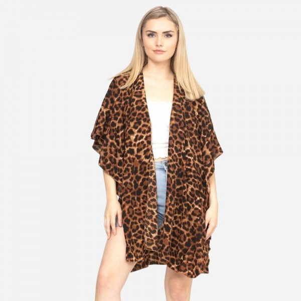 "Women's leopard print ruffle kimono.  - One size fits most 0-14 - Approximately 33"" L - 100% Polyester"