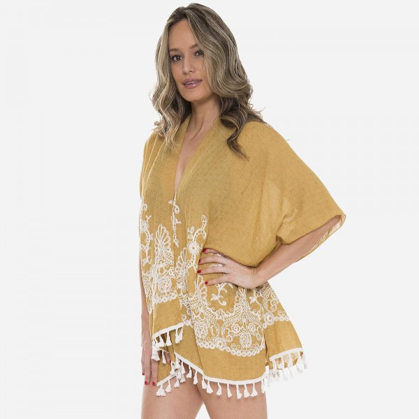 "Women's lightweight floral embroidered tassel kimono.  - One size fits most 0-14 - Approximately 30"" L - 100% Viscose"