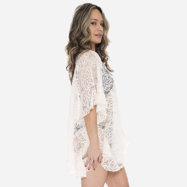 "Women's lightweight floral lace ruffle kimono.  - One size fits most 0-14 - Approximately 32"" L - 100% Polyester"