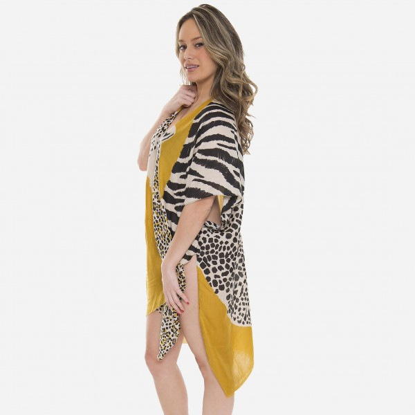 "Women's Lightweight Cheetah Print Kimono.  - One size fits most 0-14 - Approximately 37"" L - 100% Polyester"