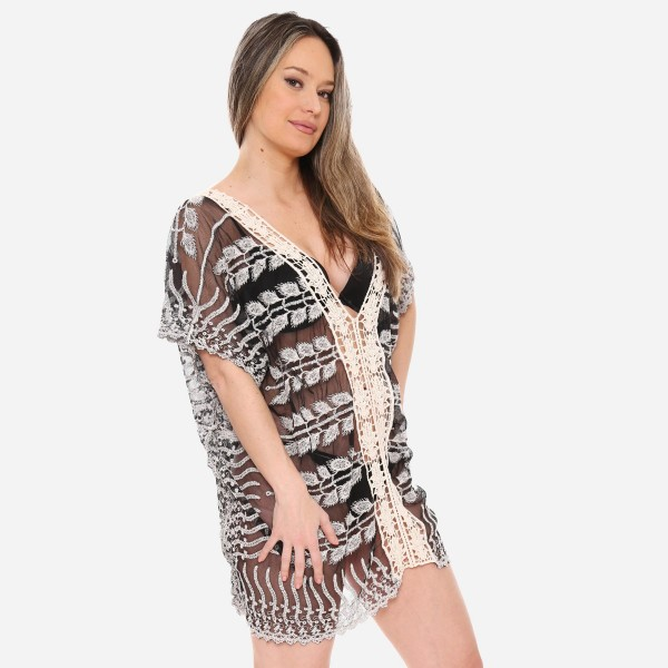 "Women's lace mesh crochet trim swimsuit cover up top.  - One size fits most 0-14 - Approximately 27"" L - 100% Viscose"