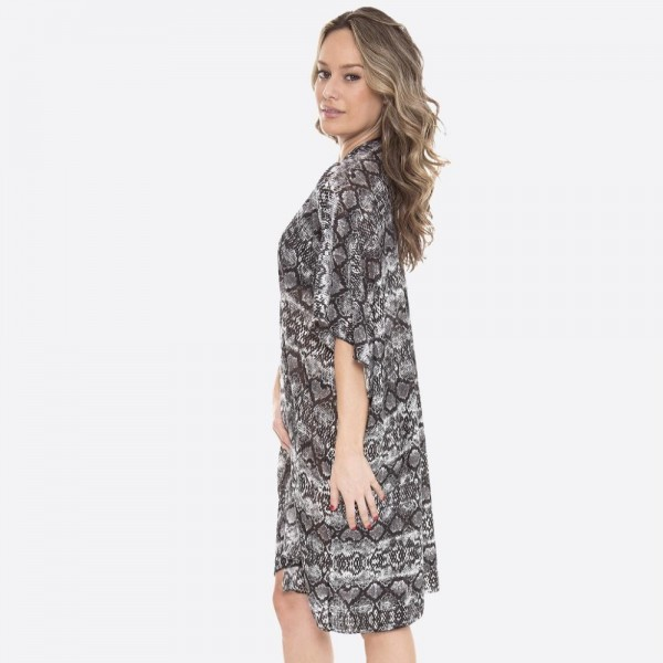 "Women's Snakeskin Kimono.  - One size fits most 0-14 - Approximately 37"" L - 100% Polyester"
