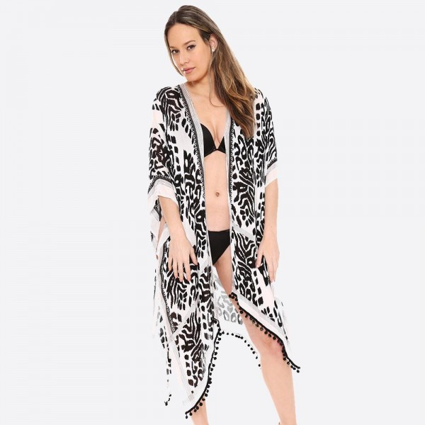 "Women's Lightweight Animal Print Kimono Featuring Pom Pom Tassel Trim.  - One size fits most 0-14 - Approximately 33"" L - 100% Viscose"