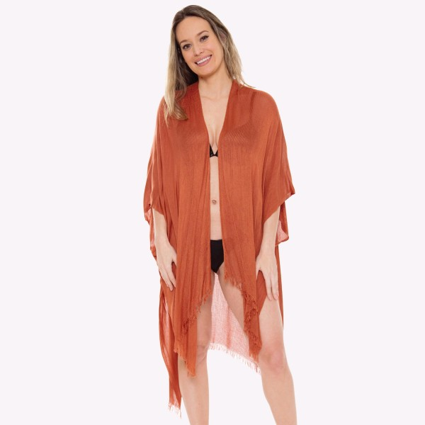 "Women's Lightweight Solid Kimono.  - One size fits most 0-14 - Approximately 43"" L - 100% Viscose"