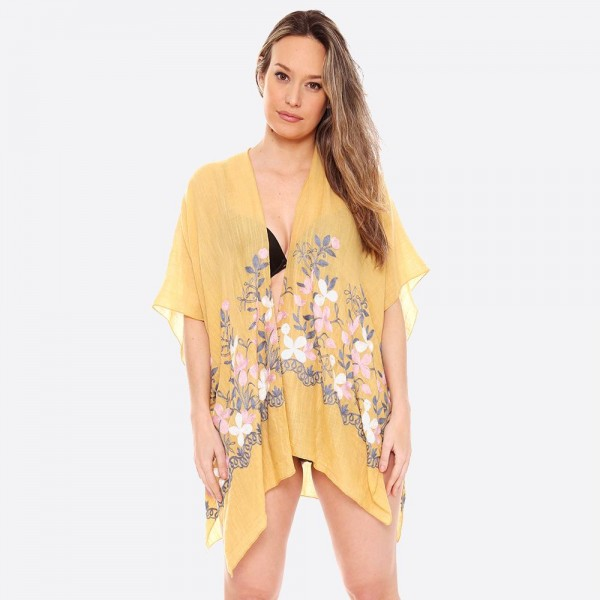 "Women's Lightweight Floral Embroidered Short Kimono.  - One size fits most 0-14 - Approximately 30"" L - 100% Viscose"