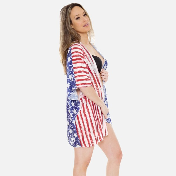 "Women's Lightweight Distressed Stars & Stripes Kimono.  - One size fits most 0-14 - Approximately 30"" L - 100% Polyester"
