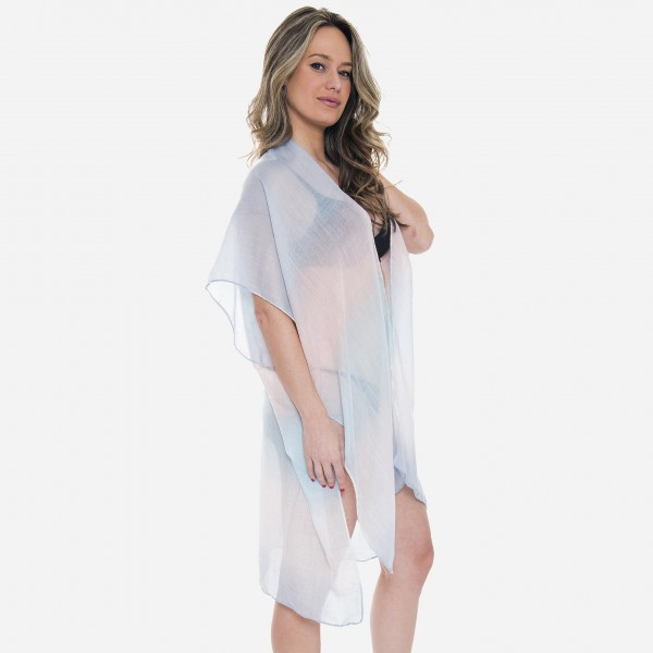 "Women's lightweight sheer ombre kimono.  - One size fits most 0-14 - Approximately 35"" L - 100% Viscose"