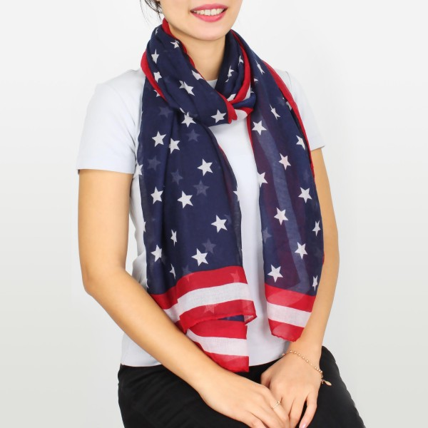 "Women's lightweight stars and stripes scarf.  - Approximately 35"" W x 74"" L - 100% Polyester"