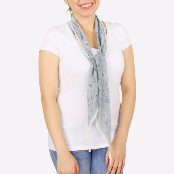 "Women's lightweight flower lace bias cut scarf with crochet trim.  - Approximately 8"" W x 62"" L - 100% Polyester"