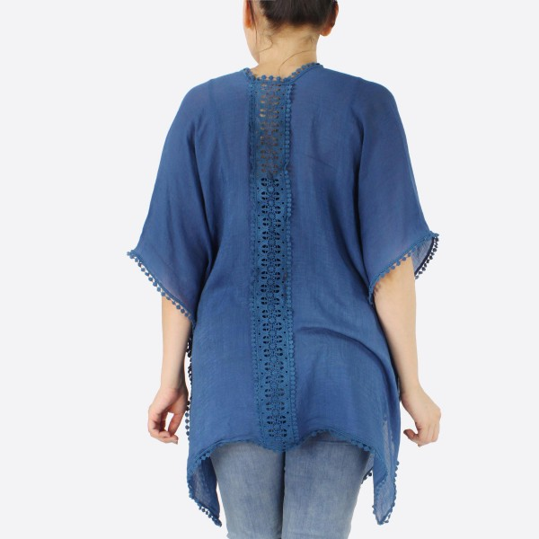 "Women's Short Lightweight Crochet Trim Kimono with Crochet Back Details.  - One size fits most 0-14 - Approximately 27"" L  - 100% Polyester"