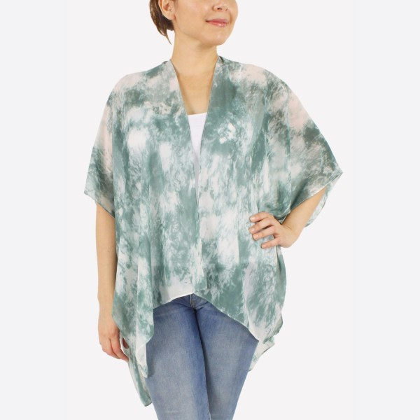 "Women's lightweight sheer marble tie-dye short kimono.  - One size fits most 0-14 - Approximately 29"" L - 100% Polyester"