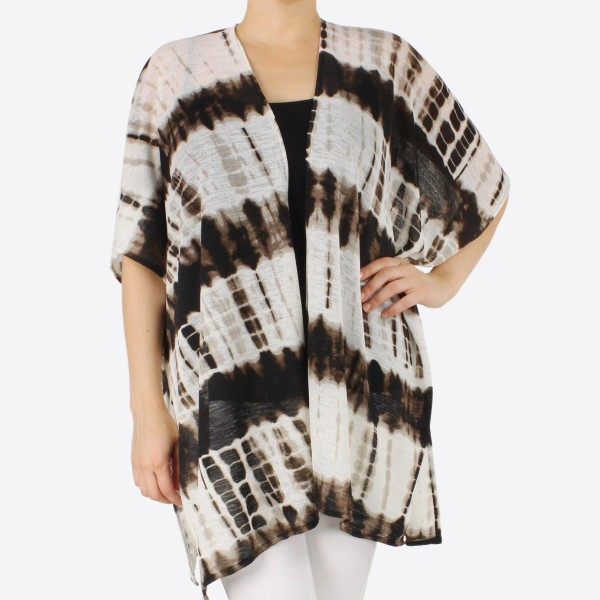 "Women's tie-dye kimono.  - One size fits most 0-14 - Approximately 33"" L - 100% Polyester"