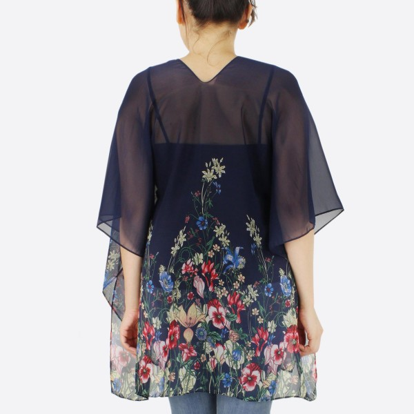 """Women's lightweight floral kimono.  - One size fits most 0-14 - Approximately 26"""" L - 100% Polyester"""