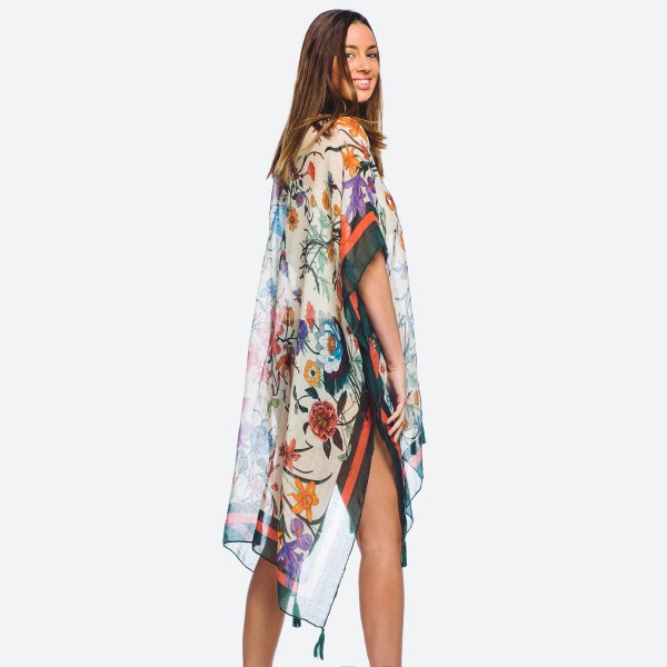 "Women's lightweight green bordered floral kimono.  - One size fits most 0-14 - Approximately 37"" L  - 100% Polyester"