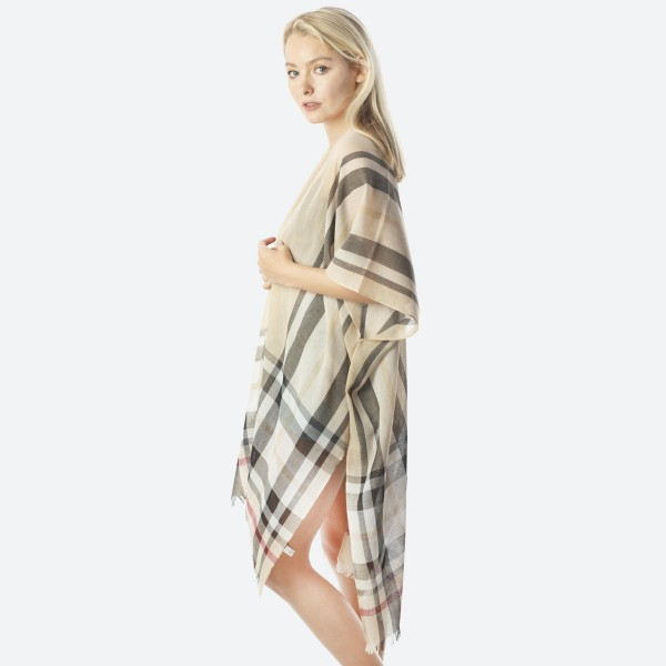 "Women's lightweight sheer Beige enlarged plaid print fringe kimono.  - One size fits most 0-14 - Approximately 40"" L - 100% Polyester"