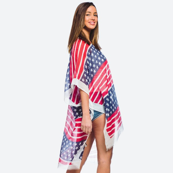 """Women's lightweight stars and stripes kimono.  - One size fits most 0-14 - Approximately 37"""" L  - 30% Cotton, 70% Polyester"""