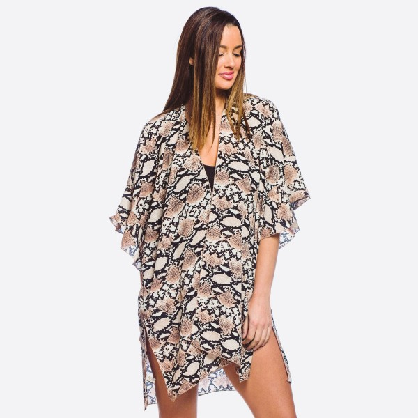 "Women's Lightweight Snakeskin Ruffle Sleeve Kimono.  - One size fits most 0-14 - Approximately 33"" L - 100% Polyester"