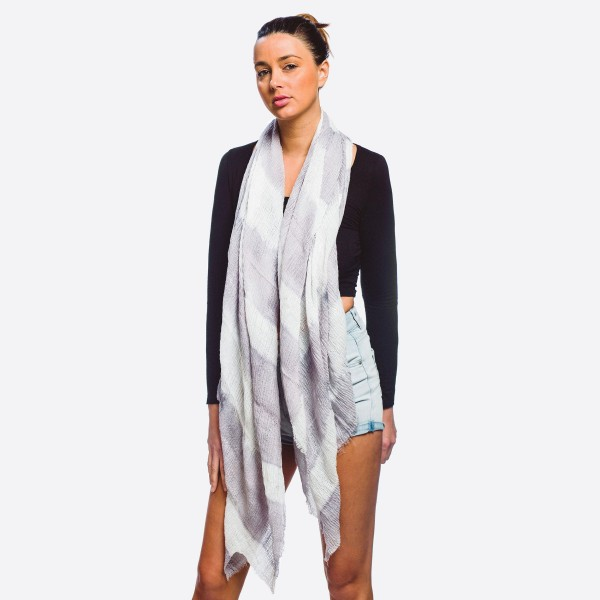 "Women's lightweight tie-dye print scarf with frayed edges.  - Approximately 37"" W x 72"" L - 20% Cotton, 80% Polyester"