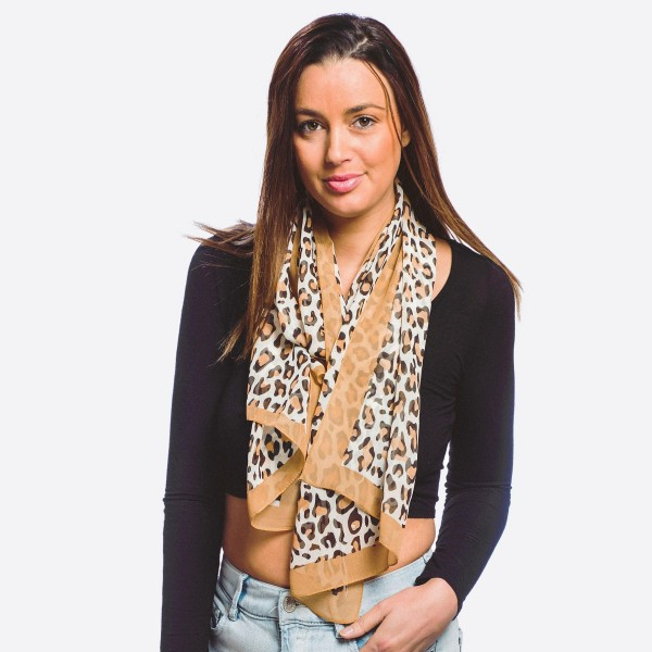"Women's lightweight sheer leopard print scarf.  - Approximately 20"" W x 60"" L - 100% Polyester"