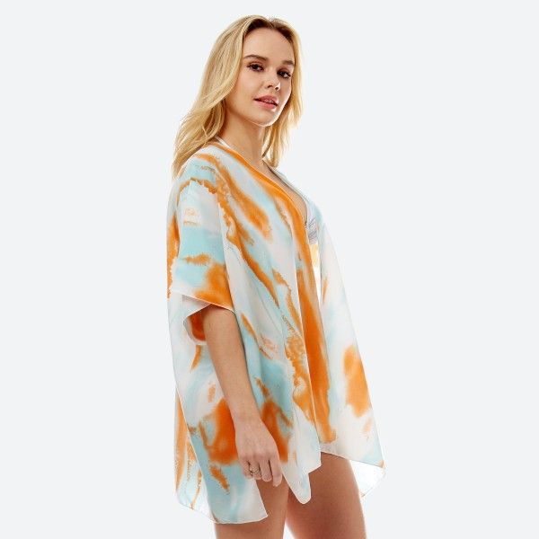"Women's lightweight watercolor tie-dye short kimono.  - One size fits most 0-14 - Approximately 29"" L - 100% Polyester"