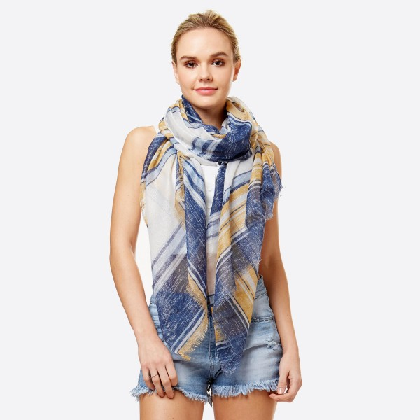 """Women's lightweight stripe scarf with metallic stitching.  - Approximately 34"""" W x 70"""" L - 100% Polyester"""