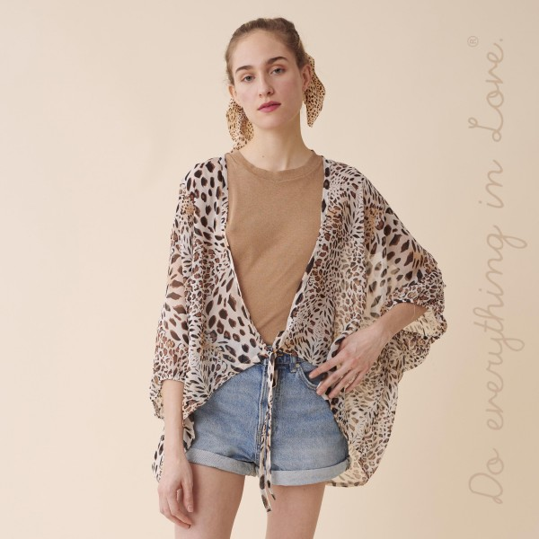 "Do everything in Love Brand Women's Lightweight Sheer Leopard Print Crop Kimono with Front Tie Detail.  - Front tie closure - One size fits most 0-14 - Approximately 25"" L - 100% Polyester"