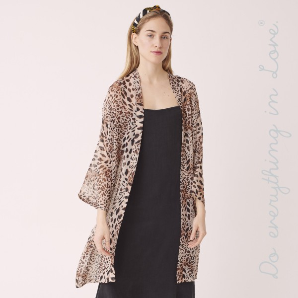 "Do everything in Love Brand Women's Lightweight Sheer Leopard Print Kimono.  - One size fits most 0-14 - Approximately 39"" L - 100% Polyester"
