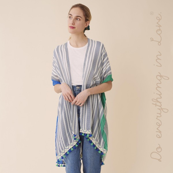 "Do everything in Love brand women's multicolor stripe kimono with tassels.  - One size fits most 0-14 - Approximately 37"" L - 100% Polyester"