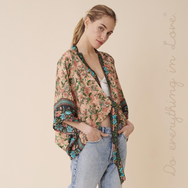 "Do everything in Love brand women's lightweight Peach oriental floral crop kimono with front tie detail.  - One size fits most 0-14 - Approximately 19"" L - 100% Viscose"