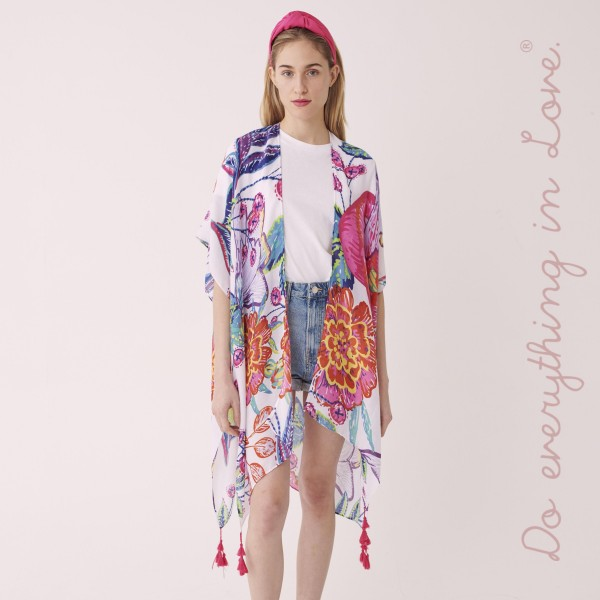 "Do everything in Love Brand Lightweight Fuchsia Floral Tassel Print Kimono.  - One size fits most 0-14 - Approximately 37"" L - 100% Polyester"