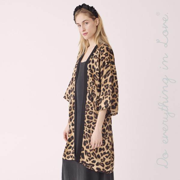 "Do everything in Love Brand Women's Leopard Print Kimono.  - One size fits most 0-14 - Approximately 39"" L - 100% Polyester"