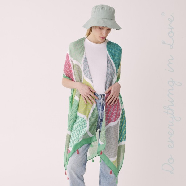 "Do everything in Love brand women's lightweight geometric tassel kimono.  - One size fits most 0-14 - Approximately 35"" L - 100% Polyester"