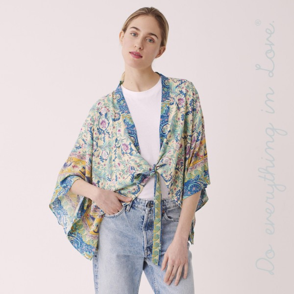 """Do everything in Love brand women's lightweight Ivory floral crop kimono with front tie detail.  - One size fits most 0-14 - Approximately 19"""" L - 100% Viscose"""