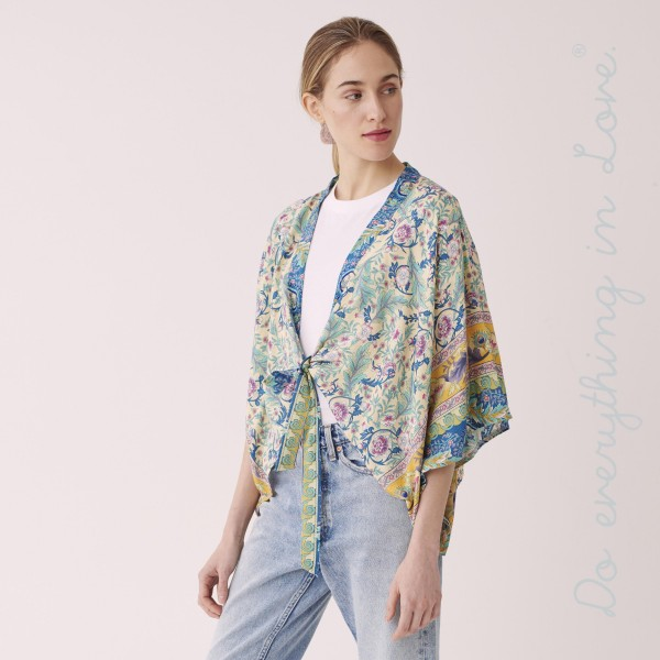 "Do everything in Love brand women's lightweight Ivory floral crop kimono with front tie detail.  - One size fits most 0-14 - Approximately 19"" L - 100% Viscose"