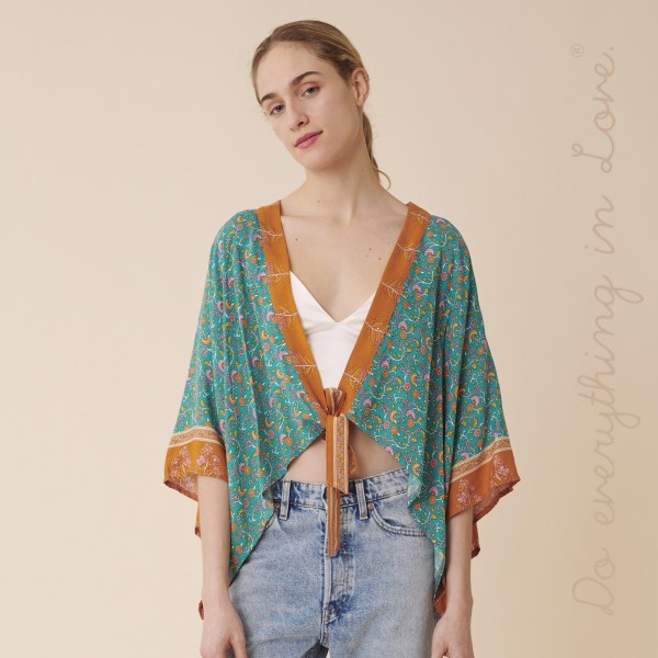 """Do everything in Love brand women's lightweight Turquoise oriental floral crop kimono with front tie detail.  - One size fits most 0-14 - Approximately 19"""" L - 100% Viscose"""