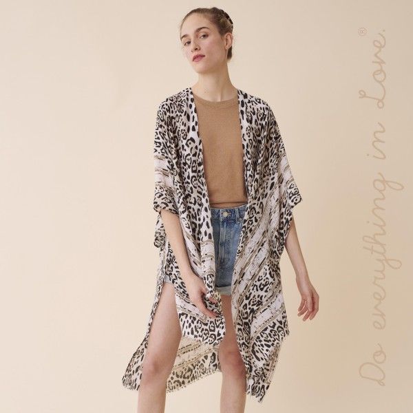 "Do everything in Love Brand Lightweight Snakeskin Stripe Border Kimono.  - One size fits most 0-14 - Approximately 37"" L - 100% Polyester"