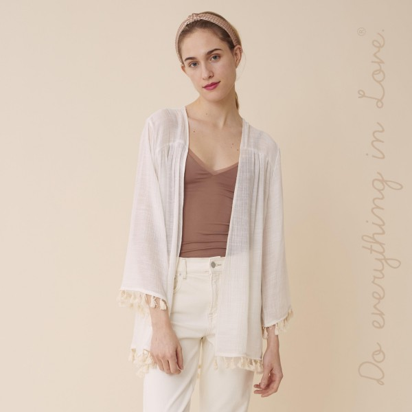 """Do everything in Love brand women's lightweight solid tassel trim cardigan.  - One size fits most 0-14 - Approximately 30"""" L - 100% Polyester"""