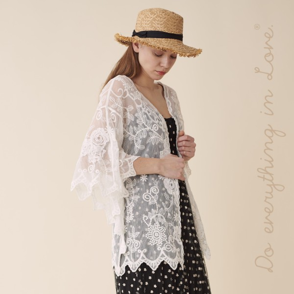 "Do everything in Love brand women's lightweight white mesh floral embroidered short kimono.  - One size fits most 0-14 - Approximately 30"" L - 100% Cotton"