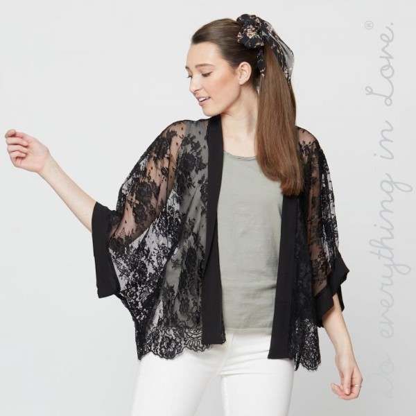 """Do everything in Love brand short black lace kimono.  - One size fits most 0-14 - Approximately 27"""" L - 100% Polyester"""
