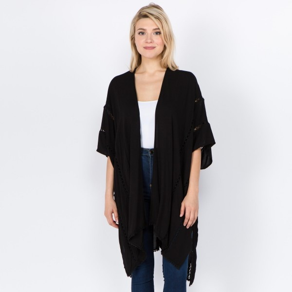 "Women's lightweight solid kimono with crochet trim.  - One size fits most 0-14 - Approximately 32"" L - 100% Viscose"