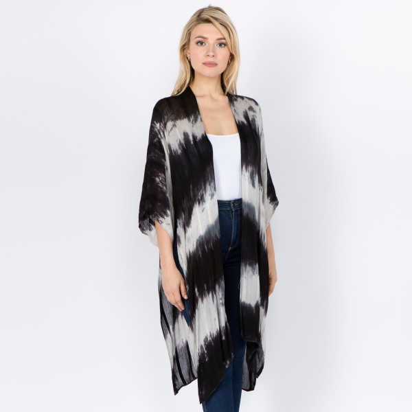 "Women's lightweight short sleeve ombre kimono with side slit details.  - One size fits most 0-14 - Approximately 40"" L - 100% Viscose"