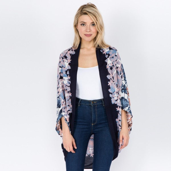 """Women's lightweight floral print kimono.  - One size fits most 0-14 - Approximately 37"""" L - 100% Viscose"""