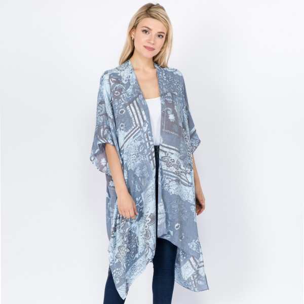 "Women's lightweight vintage floral kimono.  - One size fits most 0-14 - Approximately 37"" L - 100% Viscose"