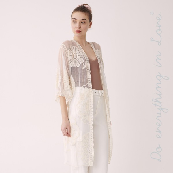 """Do everything in Love Brand Floral Lace Kimono.  - One size fits most  - Approximately 40"""" L - 65% Cotton / 35% Nylon"""